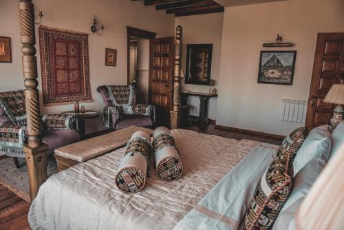 A bed or beds in a room at Yerkir Guest House