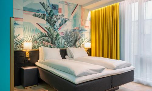Łóżko lub łóżka w pokoju w obiekcie Thon Hotel Storo