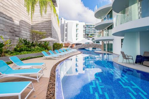 The swimming pool at or near Lets Phuket Twin Sands Resort & Spa