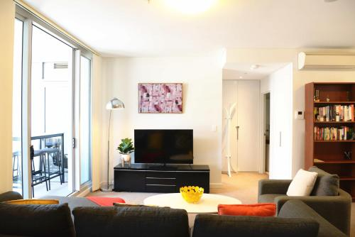 A television and/or entertainment center at New SilkRoad Apartments Airport