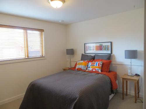 A bed or beds in a room at At Wits End B&B