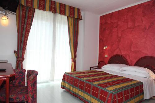 Postel nebo postele na pokoji v ubytování Hotel Soraya