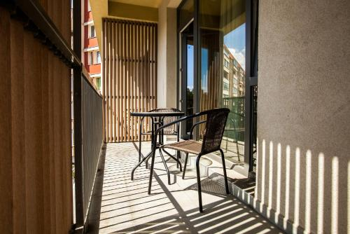 A balcony or terrace at Victoria Bulevard Hotel