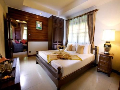 A bed or beds in a room at Smile House - SHA Plus