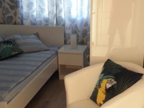 Ein Bett oder Betten in einem Zimmer der Unterkunft Villa Ingrid