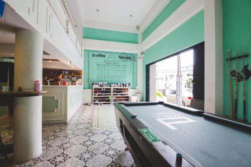 A pool table at D Hostel Bangkok
