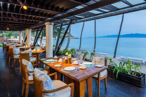 A restaurant or other place to eat at Melati Beach Resort & Spa - SHA Plus Certified