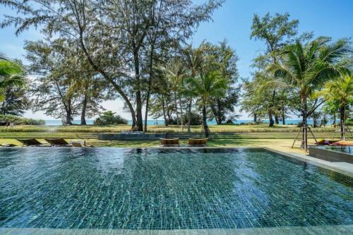 The swimming pool at or near Baan Mai Khao
