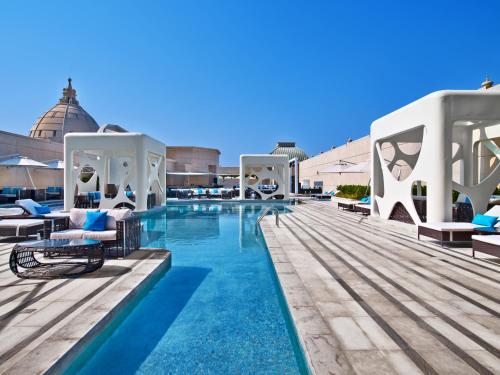 The swimming pool at or near V Hotel Dubai, Curio Collection by Hilton