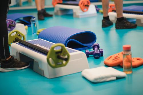 The fitness center and/or fitness facilities at ARBOREA Marina Resort Neustadt