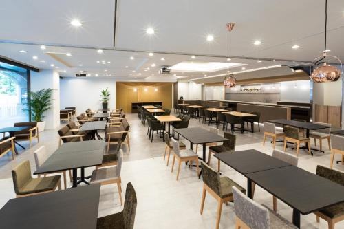 A restaurant or other place to eat at Hotel Bellclassic Tokyo