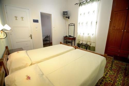 Ένα ή περισσότερα κρεβάτια σε δωμάτιο στο Plumeria Flowery