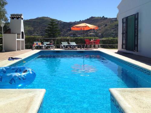 The swimming pool at or near Casa Mari Carmen