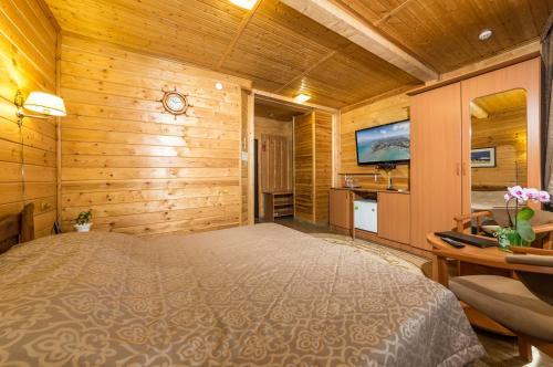 Кровать или кровати в номере Morskoy Klub Kapitan