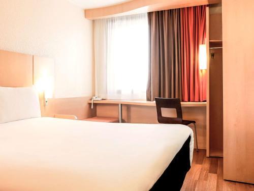 Un ou plusieurs lits dans un hébergement de l'établissement ibis Lyon Gare Part Dieu