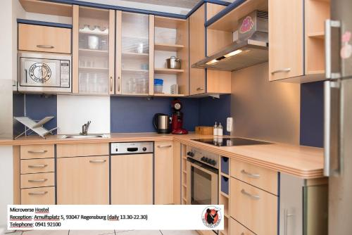 A kitchen or kitchenette at Microverse Hostel