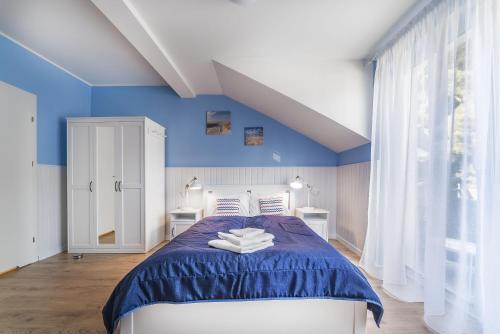 Łóżko lub łóżka w pokoju w obiekcie Papaj Resort