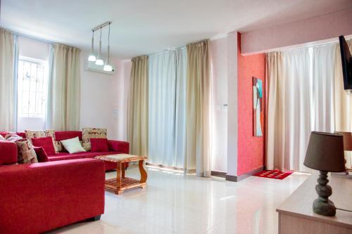 A seating area at Lotus Villa Sun Apartment
