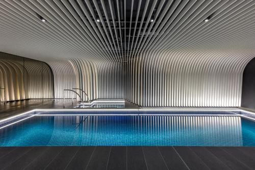 The swimming pool at or near SKYE Suites Sydney