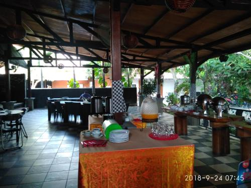 A restaurant or other place to eat at Jazz Hotel Palu