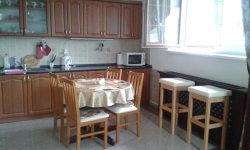 Kuchyň nebo kuchyňský kout v ubytování Belle Vue