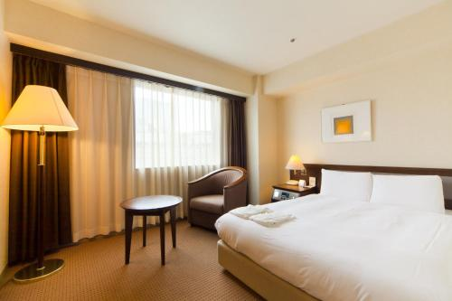 A bed or beds in a room at BEST WESTERN Hotel Nagoya