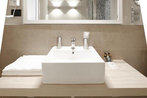 A bathroom at Hotel De Ville