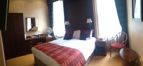 A bed or beds in a room at Belmont Hotel Leicester