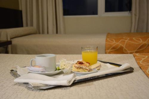Breakfast options available to guests at Hotel Cuatro Plazas