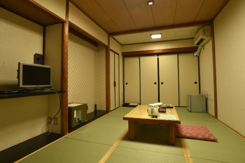 A television and/or entertainment center at Hotel Sugicho