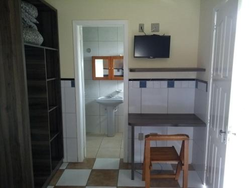 A bathroom at Ville House Hotel Canoas