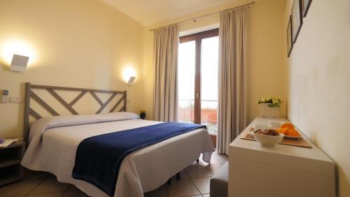 Letto o letti in una camera di Residenza Turistico Alberghiera Corallo