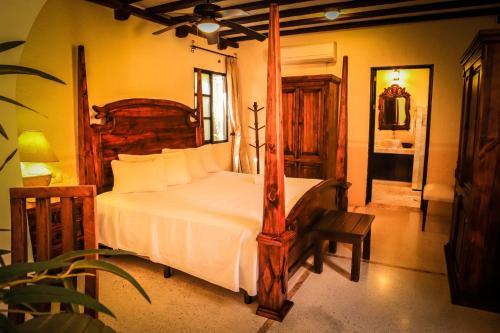 A bed or beds in a room at Casa Tia Micha