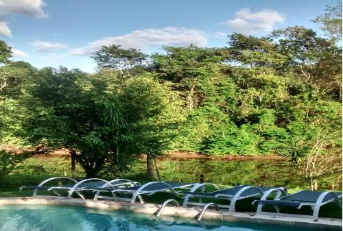 The swimming pool at or near Pousada Magia Verde
