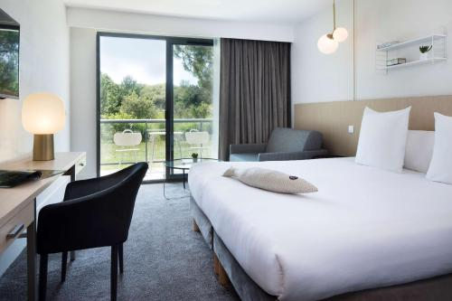 Un ou plusieurs lits dans un hébergement de l'établissement Best Western Plus Hotel les Rives du Ter