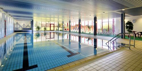 The swimming pool at or near Hessen Hotelpark Hohenroda