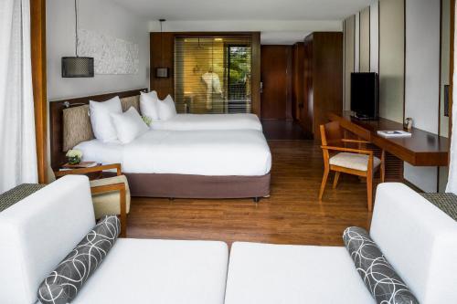 Ein Bett oder Betten in einem Zimmer der Unterkunft Sunrise Premium Resort & Spa Hoi An