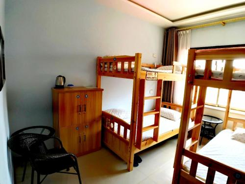 A bunk bed or bunk beds in a room at The Silk Road Travelers Hostel
