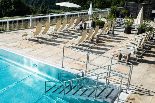 The swimming pool at or near Genusshotel Riegersburg