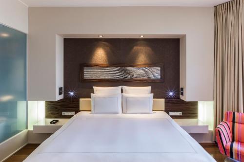 Voodi või voodid majutusasutuse Swissotel Tallinn toas