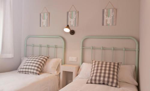 A bed or beds in a room at Senda del Cabrerizo