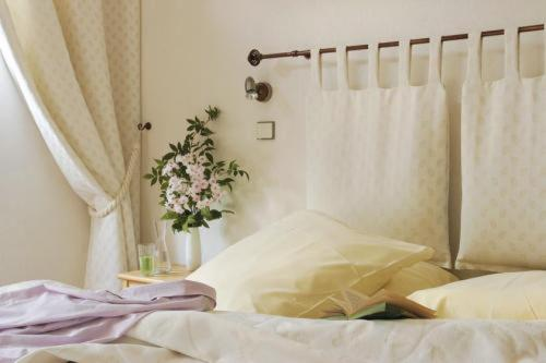 A bed or beds in a room at La Fischhutte, The Originals Relais (Relais du Silence)