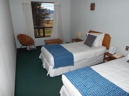 Cama o camas de una habitación en Hotel HD Natales