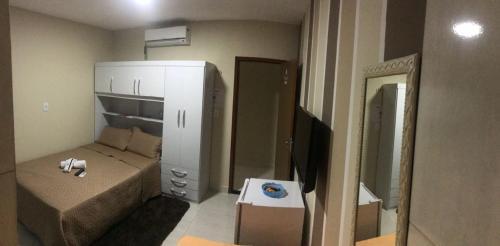 A bathroom at Flats Sâmily Mobiliados