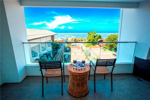 A balcony or terrace at Benoa Sea Suites and Villas