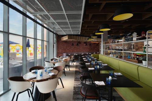 A restaurant or other place to eat at Aloft Dubai South