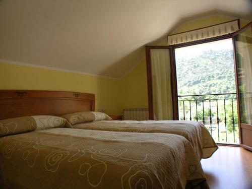 Cama o camas de una habitación en Apartamentos Puente La Molina