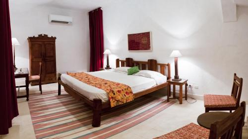 A bed or beds in a room at Neemrana's - Hill Fort - Kesroli
