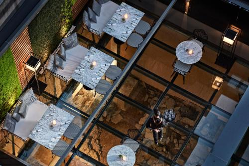 A restaurant or other place to eat at Antigon Urban Chic Hotel - The Leading Hotels of the World