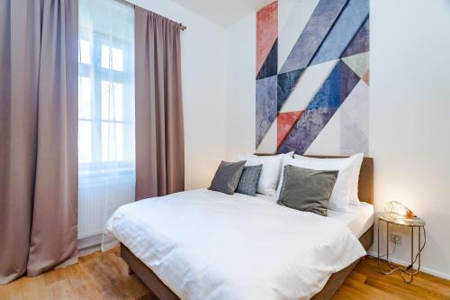 A bed or beds in a room at Seven Wishes Boutique Residence